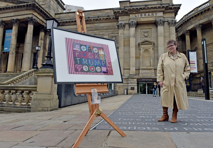 """Artist Janette Law with her work """"Any Frontier Any Hemisphere"""" which has been banned from Liverpool Central library as it says """"F**K Trump"""" on it. Picture Jason Roberts"""